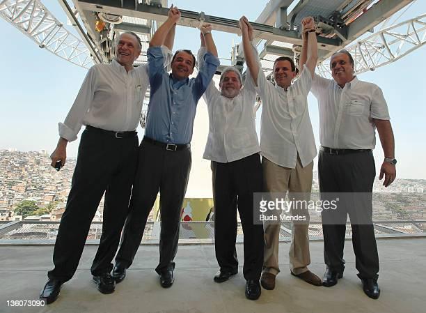 Brazil's president Luiz Inacio Lula da Silva celebrates alongside Brazilian Olympic Committee president Carlos Arthur Nuzman Rio de Janeiro state...