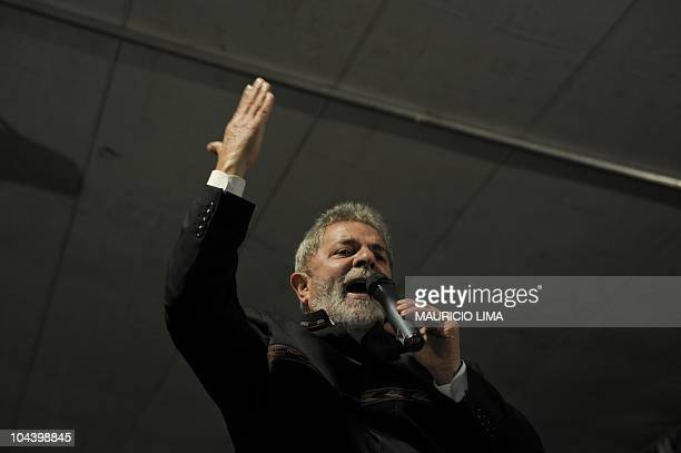 Brazil's President Luiz Inacio Lula da Silva delivers a speech during a ceremony to deliver 224 new houses as part of his Accelerated Growth Program...