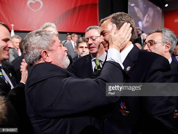 Brazil's President Luiz Inacio Lula da Silva left embraces Spain's Prime Minister Jose Luis Rodriguez Zapatero after it was announced that Rio de...