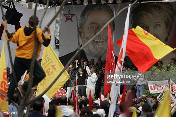 Brazil's President Luiz Inacio Lula da Silva raises the arm of Sao Paulo's mayoral candidate Marta Suplicy of the Workers Party and her deputy Aldo...