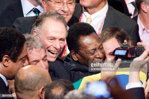Brazil's President Luiz Inacio Lula da Silva Rio 2016 bid President Carlos Arthur Nuzman and Brazilian football legend Pele celebrate with their...