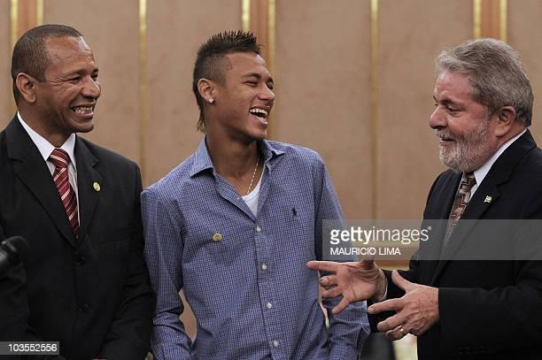 Brazil's President Luiz Inacio Lula da Silva shares a joke with footballer Neymar of Brazilian club Santos FC and his father also Neymar during a...