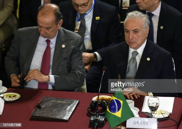 Brazil's President Michel Temer and his Foreign Affairs Minister Aloysio Nunes attend the Mercosur President's Summit in Montevideo on December 18...