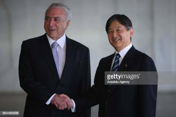 Brazil's President Michel Temer shakes hands with the Crown Prince of Japan His Imperial HIghness Naruhito during the opening ceremony of the 8th...