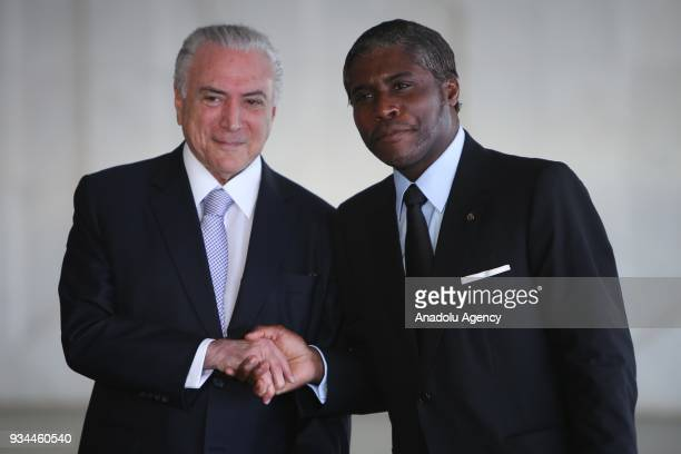 Brazil's President Michel Temer shakes hands with VicePresident of Equatorial Guinea Teodoro Obiang Mangue during the opening ceremony of the 8th...