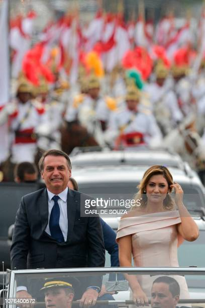 Brazil's Presidentelect Jair Bolsonaro and his wife Michelle Bolsonaro lead the presidential convoy towards the National Congress for his swearingin...