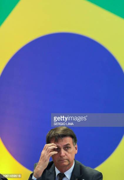 Brazil's Presidentelect Jair Bolsonaro gestures during a meeting with the newly elected governors in Brasilia on November 14 2018
