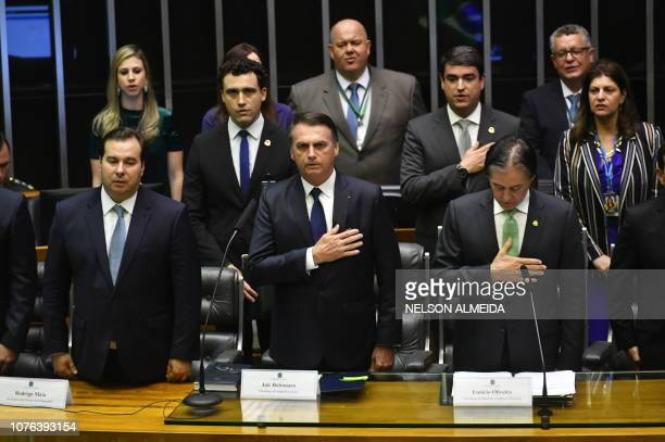 TOPSHOT Brazil's Presidentelect Jair Bolsonaro listens to the national anthem at the Congress before he is sworn in as Brazil's new president in...