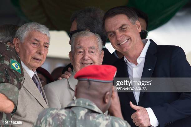 Brazil's Presidentelect Jair Bolsonaro poses for a photo during the graduation ceremony of new paratroopers at the Parachute Infantry Battalion Vila...