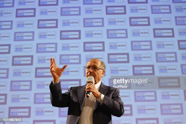 Brazil's presidential candidate and former governor of the state of Sao Paulo Geraldo Alckmin attends a lecture in Sao Paulo Brazil on August 10 2018