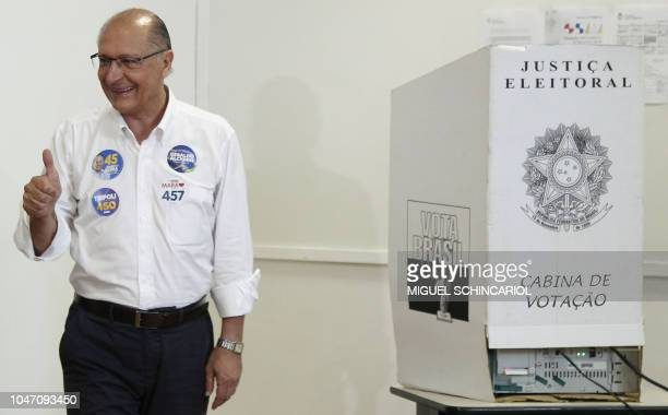 Brazil's presidential candidate for the Brazilian Social Democratic Party Geraldo Alckmin gives his thumb up after voting during general elections in...