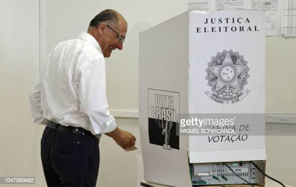 Brazil's presidential candidate for the Brazilian Social Democratic Party Geraldo Alckmin prepares to cast his vote during general elections in Sao...