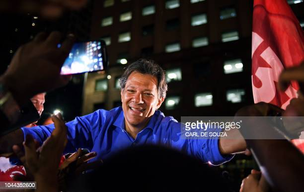 Brazil's presidential candidate for the Workers' Party Fernando Haddad greets supporters during a campaign rally in Rio de Janeiro Brazil on October...