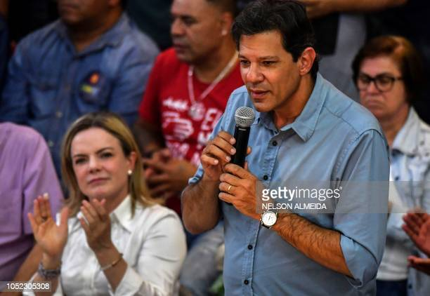 Brazil's presidential candidate for the Workers' Party Fernando Haddad speaks next to the president of the PT Gleisi Hoffmann during a meeting with...