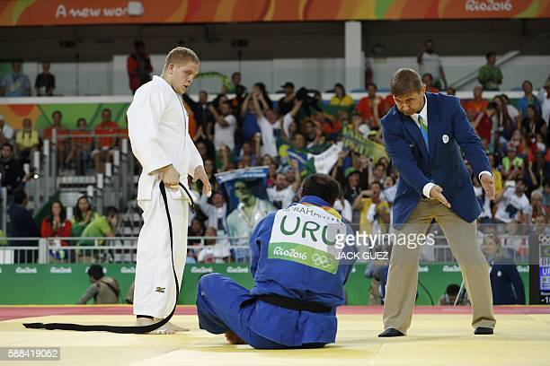 Brazil's Rafael Buzacarini competes with Uruguay's Pablo Aprahamian during their men's -100kg judo contest match of the Rio 2016 Olympic Games in Rio...