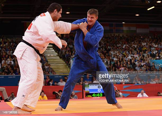 Brazil's Rafael Silva competes with Lithuania's Marius Paskevicius during their men's 100kg judo contest match of the London 2012 Olympic Games on...