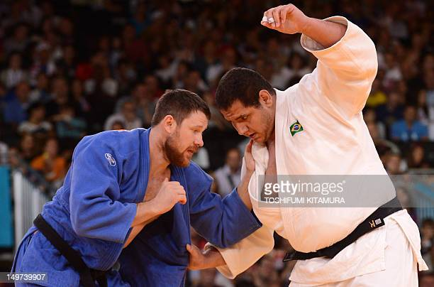 Brazil's Rafael Silva competes with Russia's Alexander Mikhaylin during their men's 100kg judo contest quarter final match of the London 2012 Olympic...