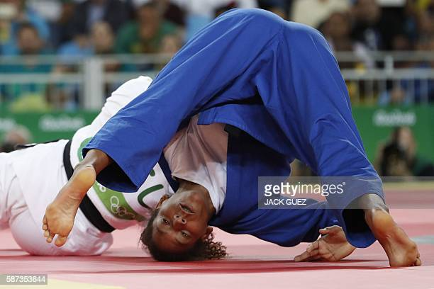 Brazil's Rafaela Silva competes with Mongolia's Sumiya Dorjsuren during their women's 57kg judo contest gold medal match of the Rio 2016 Olympic...