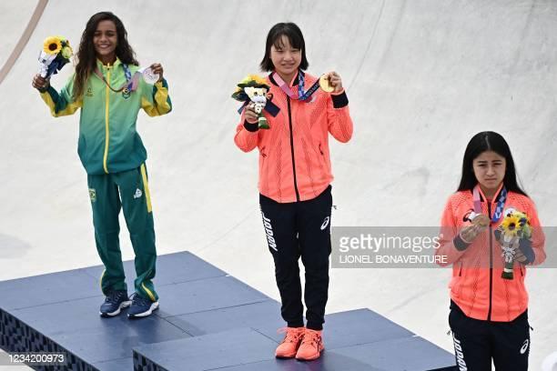 Brazil's Rayssa Leal , Japan's Momiji Nishiya and Japan's Funa Nakayama pose during the medal ceremony of the podium ceremony of the skateboarding...