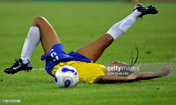 Brazil's Renata Costa falls after getting tripped by an Australian defender in the penalty area to set up a penalty taken by Marta for the team's...