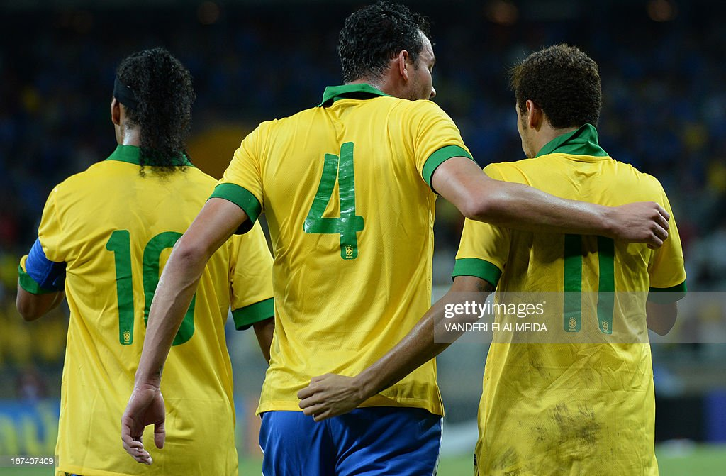 Brazil's Rever (L) celebrates with Neymar (11) after scoring against Chile, during their friendly football match at the Mineirao stadium, in Belo Horizonte, Minas Gerais on April 24, 2013.