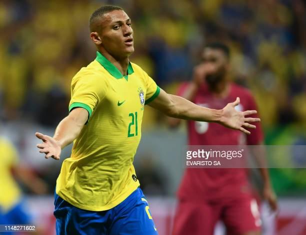 Brazil's Richarlison celebrates scoring against Qatar during a friendly football match at the Mane Garrincha stadium in Brasilia on June 5 ahead of...