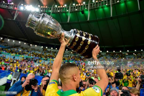 Brazil's Richarlison displays the trophy to the crowd after winning the Copa America by defeating Peru in the final match of the football tournament...