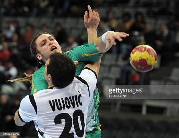 Brazil's right back Oswaldo Guimaraes vies with Montenegro's centre back Stevan Vujovic during the 23rd Men's Handball World Championships...