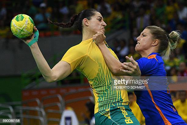 TOPSHOT Brazil's right wing Eduarda Amorim vies with Netherlands' centre back Nycke Groot during the women's quarterfinal handball match Brazil vs...