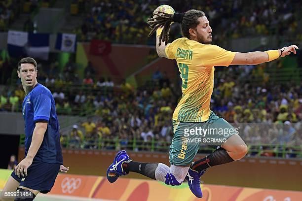 TOPSHOT Brazil's right wing Fabio Chiuffa jumps to shoot during the men's preliminaries Group B handball match Sweden vs Brazil for the Rio 2016...