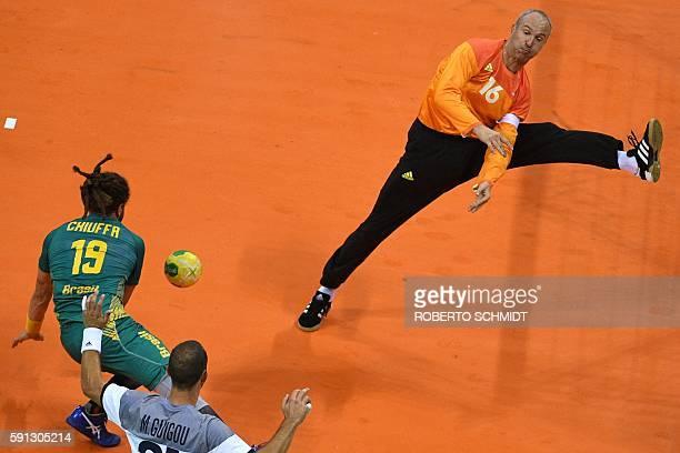 TOPSHOT Brazil's right wing Fabio Chiuffa shoots at France's goalkeeper Thierry Omeyer during the men's quarterfinal handball match Brazil vs France...