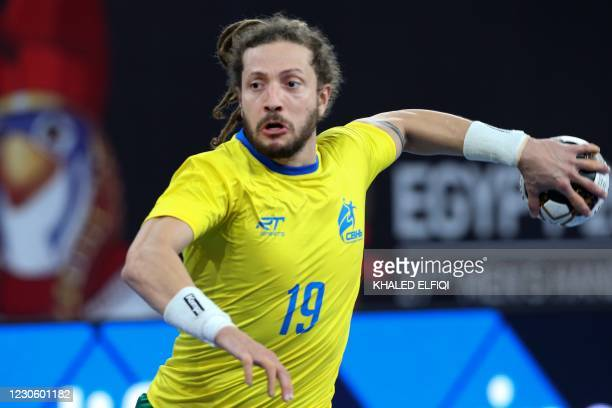 Brazil's right winger Fabio Chiuffa attempts a shot during the 2021 World Men's Handball Championship match between Group B teams Spain and Brazil at...