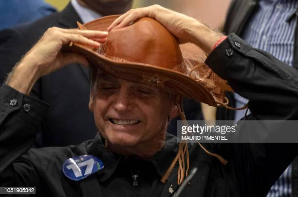 Brazil's rightwing presidential candidate for the Social Liberal Party Jair Bolsonaro gestures during a press conference in Rio de Janeiro Brazil on...