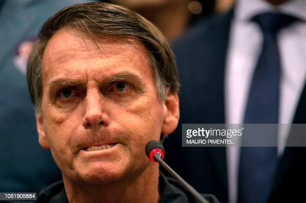 TOPSHOT Brazil's rightwing presidential candidate for the Social Liberal Party Jair Bolsonaro gestures during a press conference in Rio de Janeiro...