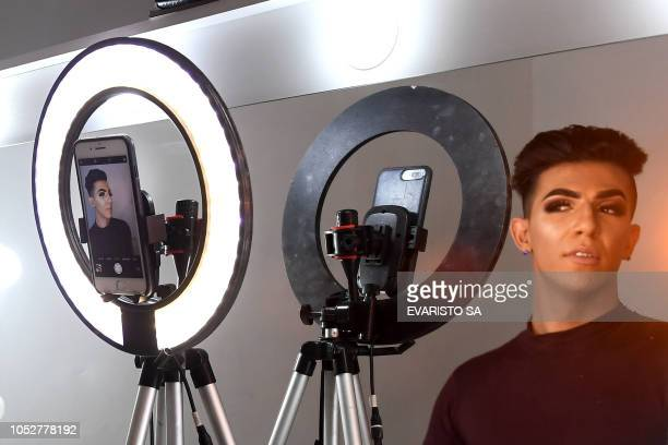 Brazil's rightwing presidential candidate for the Social Liberal Party Jair Bolsonaro's supporter makeup stylist David Maick Trabuco poses during an...