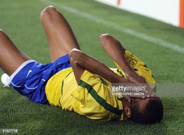 Brazil's Rivaldo reacts after a foul 03 June 2002 in Ulsan's Munsu Football Stadium during a Group C match between Turkey and Brazil in the 2002 FIFA...