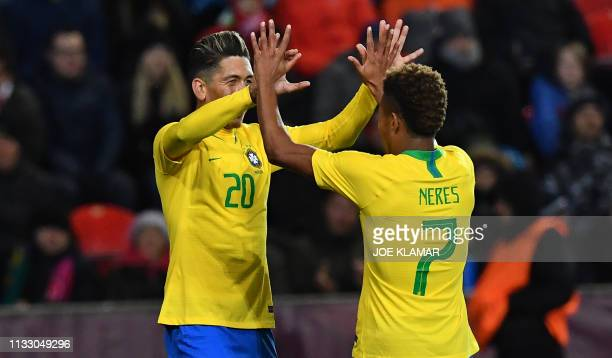 Brazil's Roberto Firmino and Brazil's David Neres celebrates their goal during the friendly football match between the Czech Republic and Brazil at...