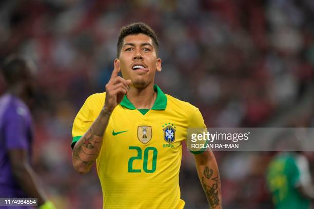 Brazil's Roberto Firmino celebrates after scoring a goal during the friendly international football match between Brazil and Senegal at the National...