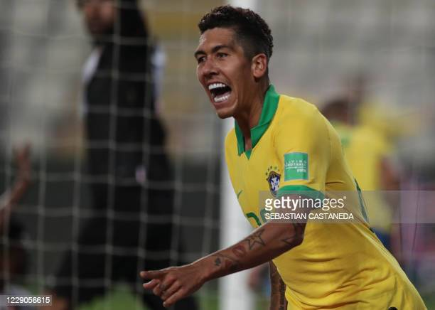 Brazil's Roberto Firmino celebrates after teammate Richarlison pushed his header into the goal to score against Peru during their 2022 FIFA World Cup...