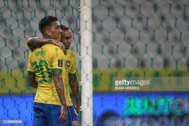 Brazil's Roberto Firmino celebrates with teammate Everton after scoring against Bolivia during their 2022 FIFA World Cup South American qualifier...