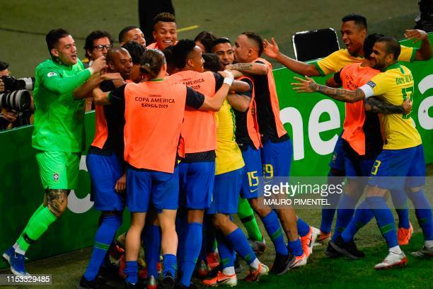 Brazil's Roberto Firmino celebrates with teammates after scoring against Argentina during their Copa America football tournament semifinal match at...