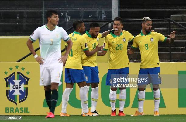 Brazil's Roberto Firmino celebrates with teammates after scoring against Bolivia during their 2022 FIFA World Cup South American qualifier football...