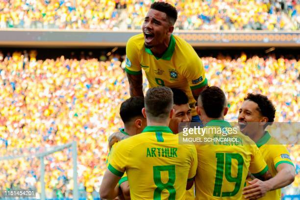 TOPSHOT Brazil's Roberto Firmino celebrates with teammates after scoring the team's second goal against Peru during their Copa America football...