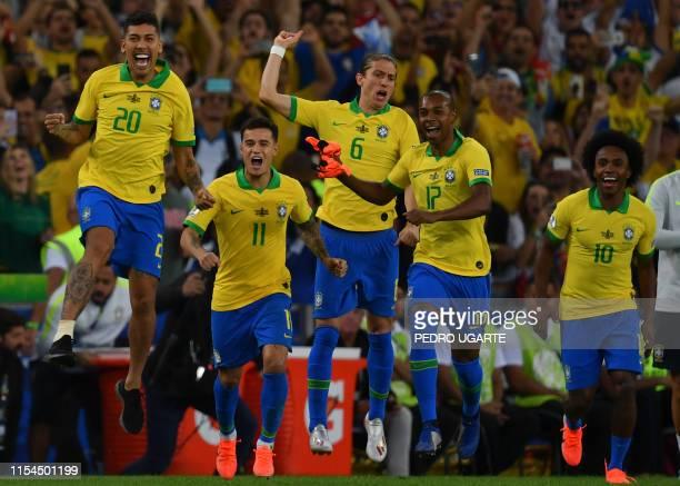 TOPSHOT Brazil's Roberto Firmino Philippe Coutinho Filipe Luis Fernandinho and Willian celebrate after winning the Copa America after defeating Peru...