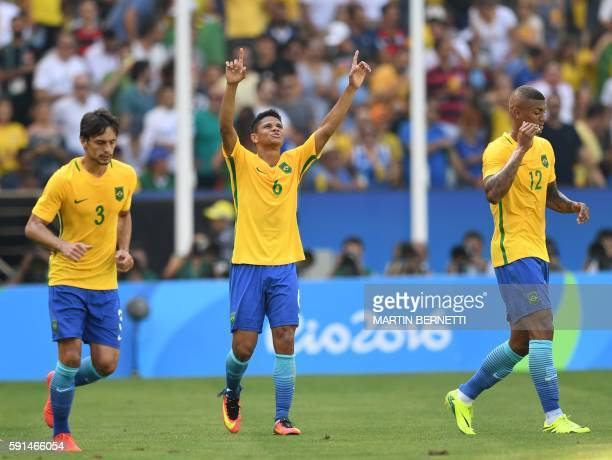 Brazil's Rodrigo Caio Douglas Santos and Walace celebrate a team's goal against Honduras during their Rio 2016 Olympic Games men's football semifinal...
