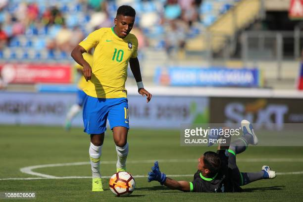 Brazil's Rodrygo vies for the ball with Bolivia's goalkeeper Jhon Cuellar during their South American U20 football match at El Teniente stadium in...