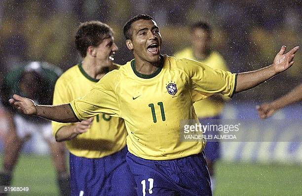 Brazil's Romario celebrates his third goal in the game against Bolivia 03 September during the World Cup 2002 qualification game in Maracana Stadium...