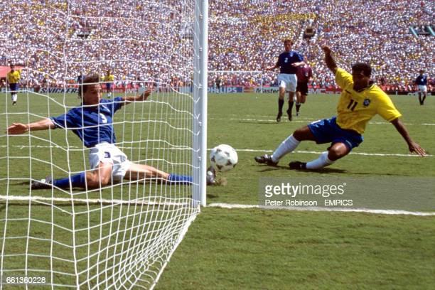 Brazil's Romario is denied a goal by the sliding intervention of Italy's Antonio Benarrivo