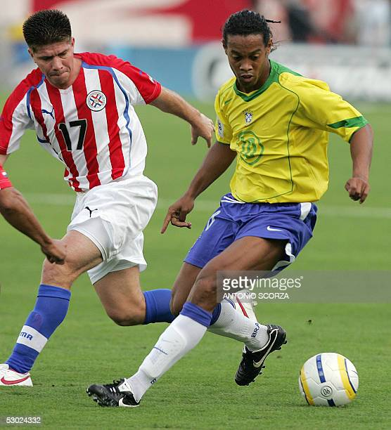 Brazil's Ronaldinho Gaucho fights for the ball with Paraguay's Pedro Saravia 05 June 2005 during their Germany 2006 FIFA World Cup South American...