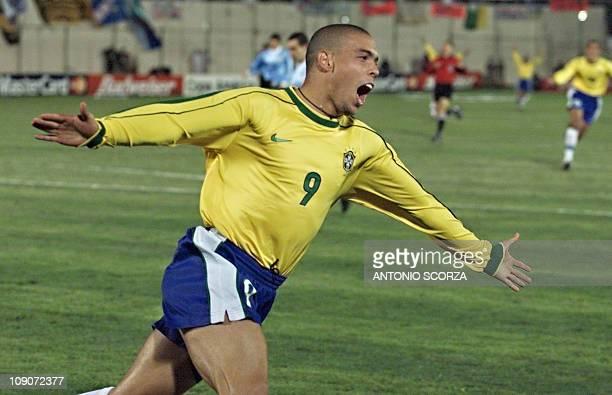 Brazil's Ronaldo celebrates after scoring the third goal against Uruguay 18 July in the Copa America final in Asuncion AFP PHOTO Antonio SCORZA